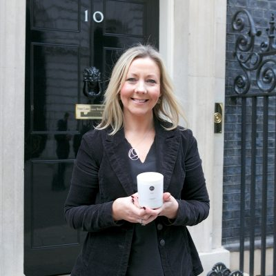 Outside Number 10 Downing Street with my luxury candle